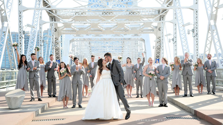 An outdoor riverfront ceremony at The Bridge Building Event Spaces.
